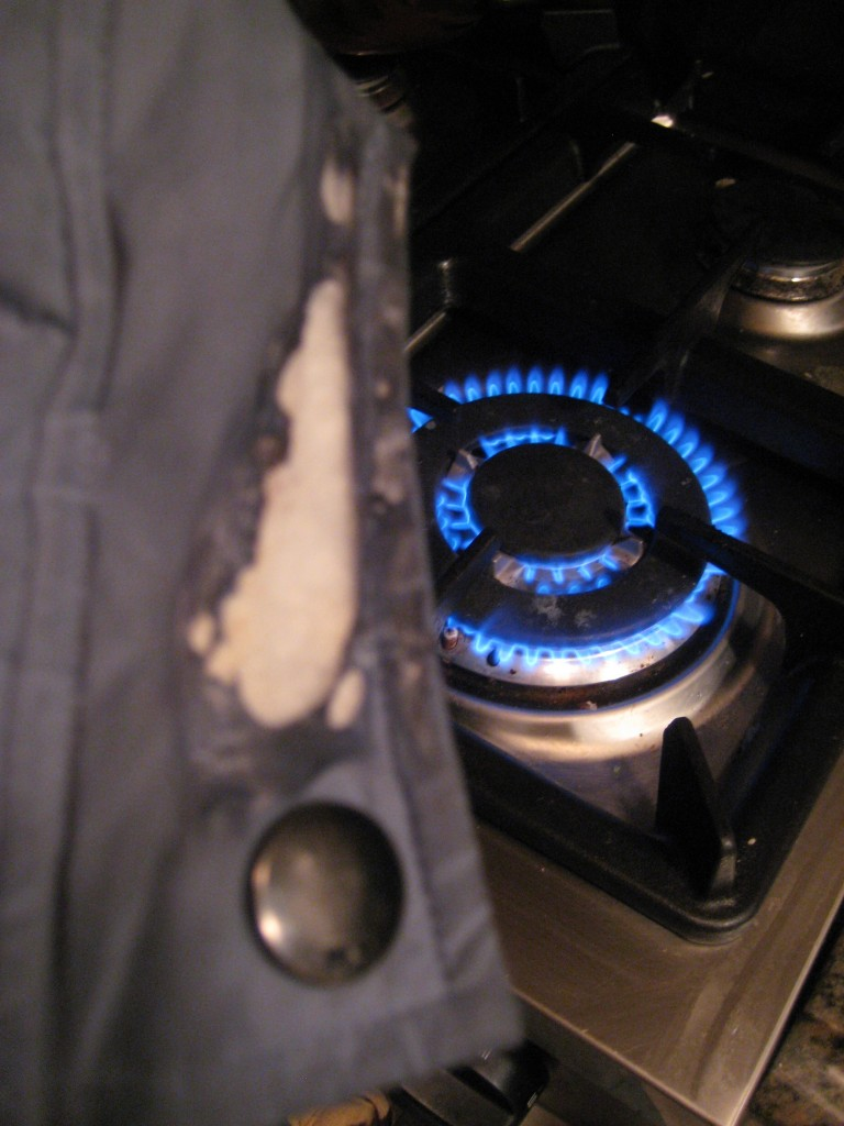 picture of the burnt jacket next to the stove element