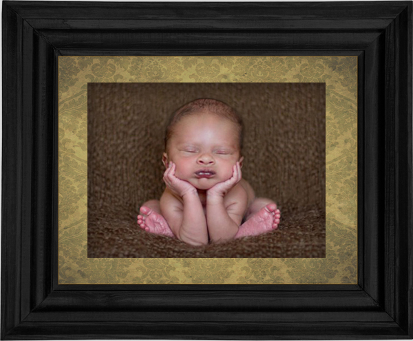"trendy ""head in hands"" newborn pose"