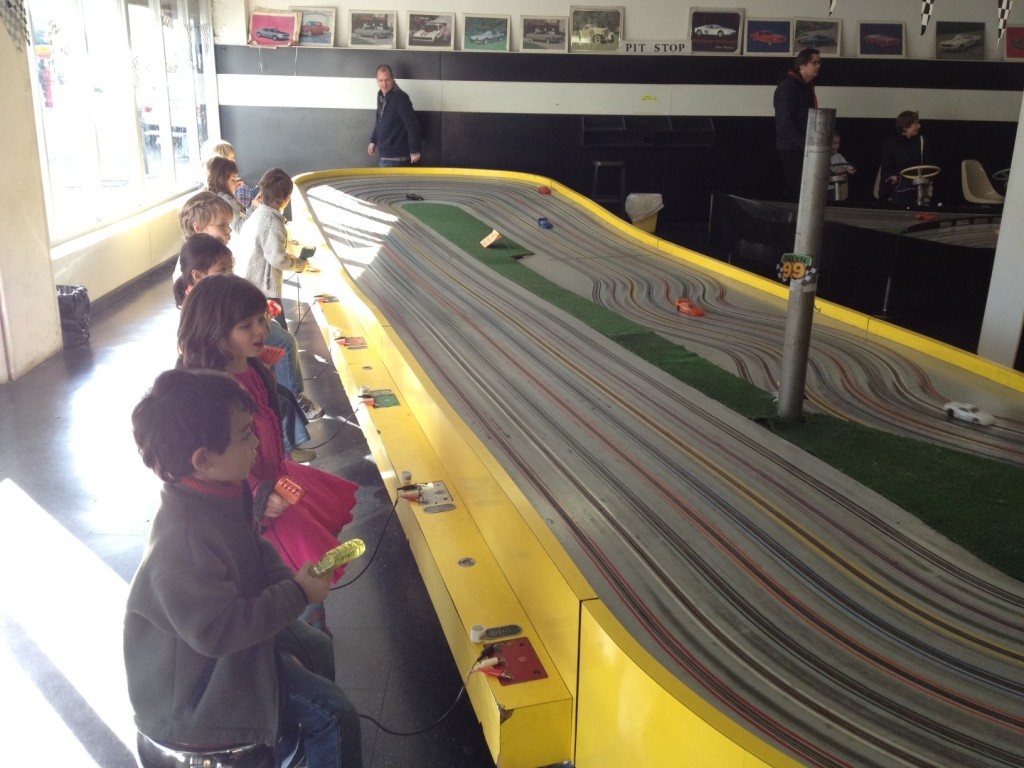 kids enjoying the one of a kind Buzz-a-rama slotcars in Kensington